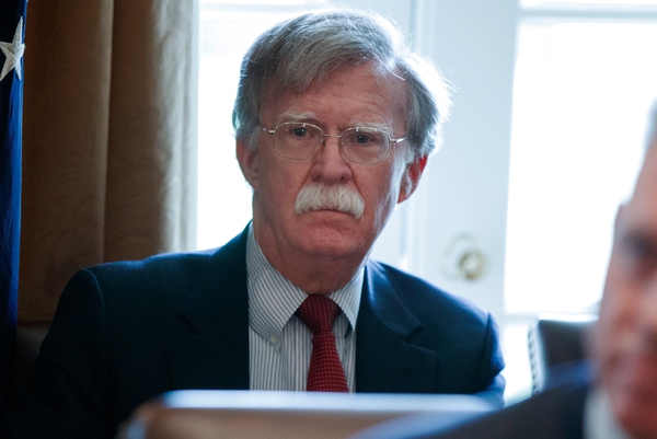 FILE - In this April 9, 2018 file photo, National security adviser John Bolton listens as President Donald Trump speaks during a cabinet meeting at the White House in Washington. Shortly before he became Trump's national security adviser, John Bolton told Radio Free Asia that nuclear negotiations with North Korea should be similar to past discussions with Libya, which dismantled its rudimentary nuclear program in the 2000s. (AP Photo/Evan Vucci, File)