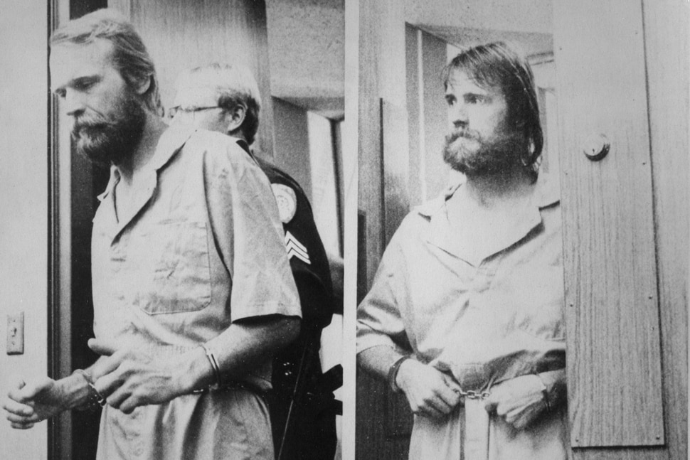 (AP file photo) Ron Lafferty, left, and his brother, Dan, were shackled Thursday as they appeared in Washoe District court for an extradition hearing in 1984. The brothers, accused of killing their sister-in-law and her toddler, won a weeks delay to give them time to fight being returned to Utah, where the killings ocurred.