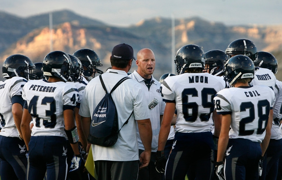 (Scott Sommerdorf | The Salt Lake Tribune) Duchesne head coach Jerry Cowan talks with his team after pre-game drills. The Eagles would go on to an easy 35-0 win against Carbon High which ran their winning streak to 37 games, setting the Utah state record for consecutive wins, Friday, September 6, 2013.