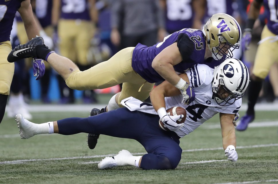 FILE - In this Sept. 29, 2018, file photo, Washington linebacker Ben Burr-Kirven (25) tackles Brigham Young running back Lopini Katoa (4) during the first half of an NCAA college football game, in Seattle. Burr-Kirven is No. 2 in the country in tackles heading into Friday's Apple Cup against No. 7 Washington State. (AP Photo/Ted S. Warren, File)
