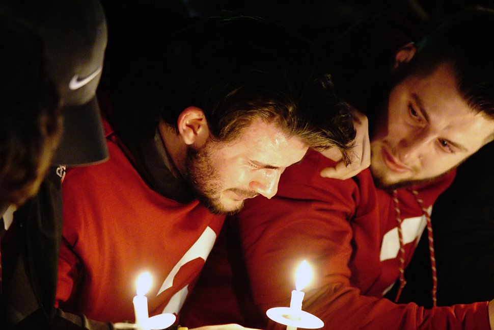Washington State quarterback Luke Falk cries during a candlelight memorial service for fellow quarterback Tyler Hilinski, Friday, Jan. 19, 2018, in Pullman, Wash. Hilinski, a sophomore, committed suicide earlier in the week. (Kai Eiselein/Moscow-Pullman Daily News via AP)