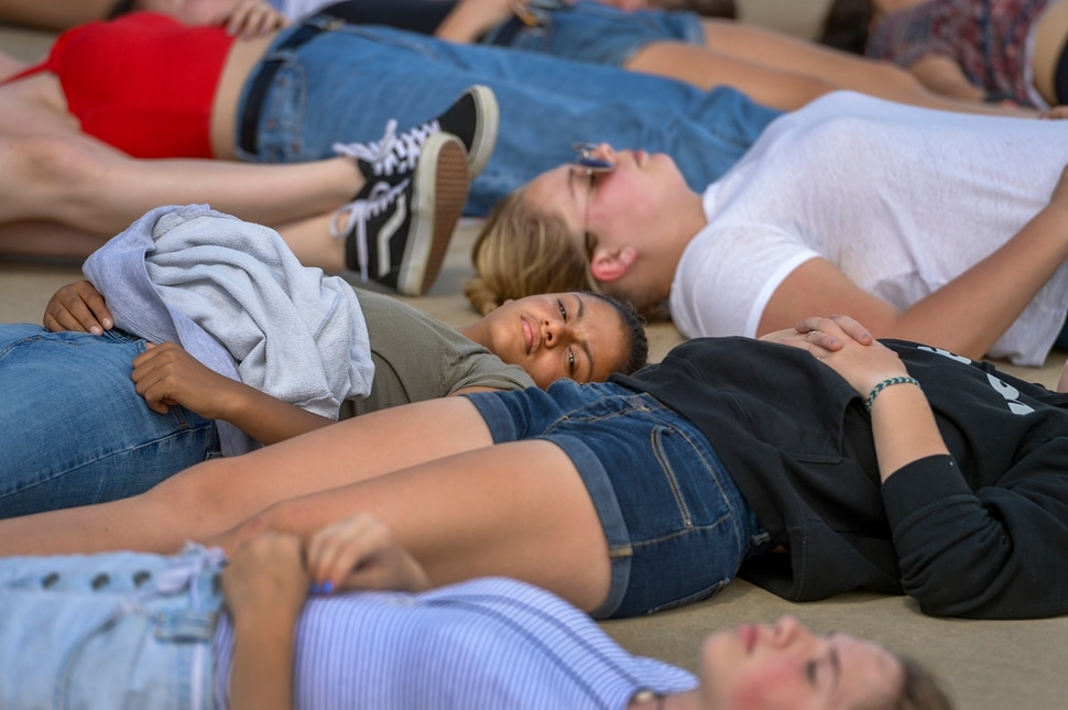 (Leah Hogsten | The Salt Lake Tribune) West High School freshman Zoey Doulson participates in the 22-minute die-in for the 22 school shootings already in 2018. Members of March For Our Lives SLC members and concerned citizens gather at the Utah Capitol, Friday, May 18, 2018, to demand gun reform and honor the 10 dead who were killed during Friday morning's shooting spree inside Santa Fe High School in southeast Texas.
