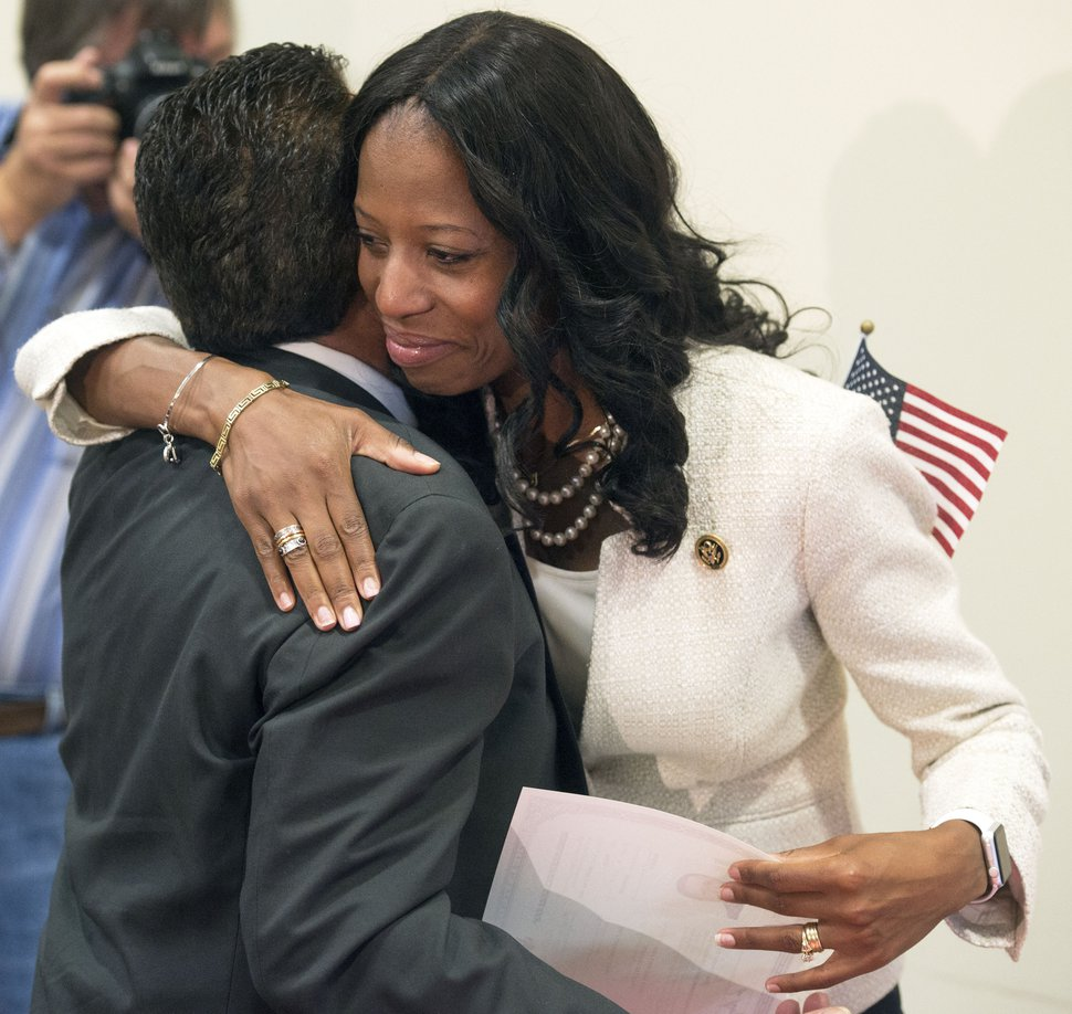 Steve Griffin | The Salt Lake Tribune After 13 immigrants became American citizens during a naturalization ceremony, Rep. Mia Love hugs new US citizen Alphonso DeLapaz as she gives him his certificate of citizenship at the South Jordan Library in Salt Lake City, Monday, August 24, 2015. Love also told the group of her family's immigration and lead them in the Pledge of Allegiance.