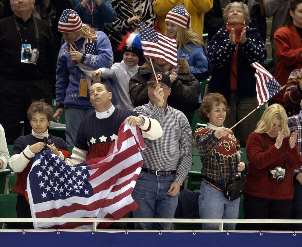 (Trent Nelson | Tribune file photo) Spectators cheer at the Men's Free Skating Finals competition at the Salt Lake Ice Center during the 2002 Olympic Winter Games.