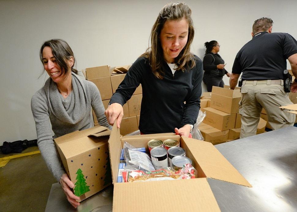 (Francisco Kjolseth   The Salt Lake Tribune) Director of the Salt Lake City Department of Public Utilities Laura Briefer, left, and Salt Lake City Mayor Erin Mendenhall work the line assembling food boxes as they volunteer at the Utah Food Bank for the Martin Luther King Jr. Day of Service on Monday, Jan. 20, 2020.