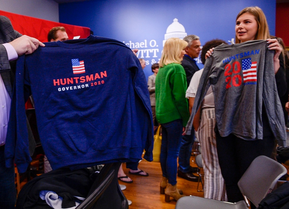 (Leah Hogsten | The Salt Lake Tribune) A Jon Huntsman campaign staff member shows off Huntsman campaign shirts on Thursday. Former two-term Gov. Jon Huntsman, 59, announced his bid for governor, Nov. 14, 2019. Huntsman fielded questions after an appearance at the Michael O. Leavitt Center for Politics and Public Service at Southern Utah University in Cedar City on Thursday.