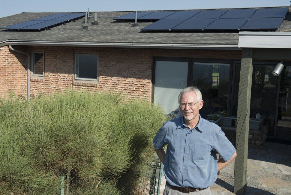 (Rick Egan | Tribune file photo) Stan Holmes' home in Salt Lake City is among 36,000 served by Rocky Mountain Power that is equipped with rooftop solar panels. Electricity generated by such panels but not used by the resident is exported onto the electrical grid and the utility customers are compensated for each excess kilowatt-hour they produce. The advocacy group Vote Solar is seeking generation and export data on all of the utility's solar customers to build a case for keeping compensation rates high.