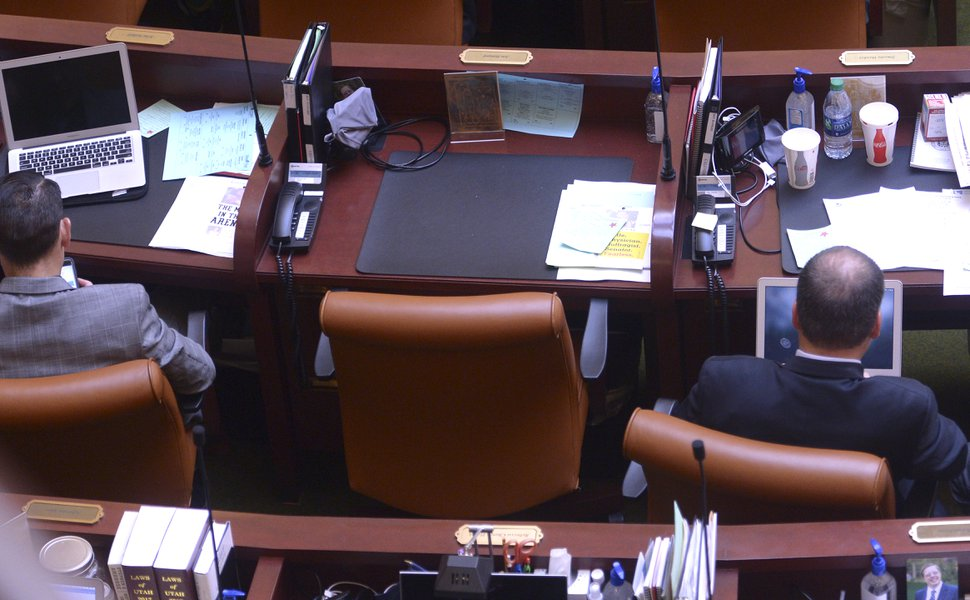 (Leah Hogsten | The Salt Lake Tribune) Notes plied up on the desk of Rep. Jon Stanard, R-St. George, who resigned from the Utah Legislative seat for