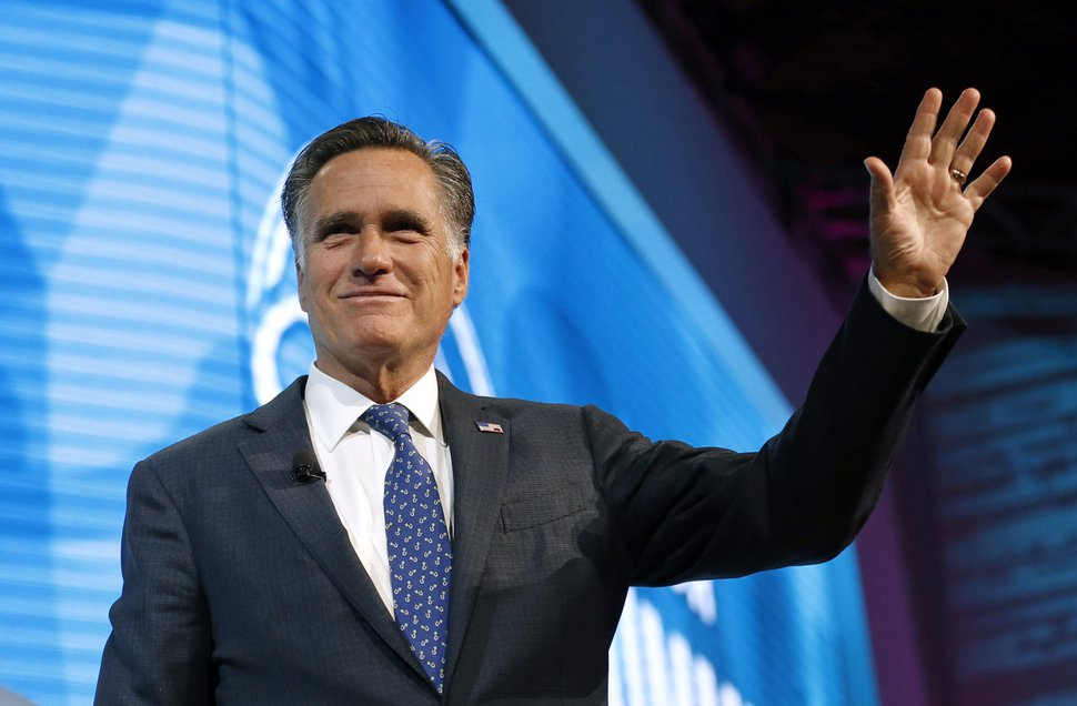 Former Republican presidential candidate Mitt Romney waves after speaking about the tech sector during an industry conference dubbed Silicon Slopes, the nickname for Utah's burgeoning cluster of tech companies Friday, Jan. 19, 2018, in Salt Lake City. Those close to the 70-year-old say he's interested in running for the Utah Senate seat being vacated by Republican Orrin Hatch and expect an announcement soon, though Romney has demurred so far. (AP Photo/Rick Bowmer)