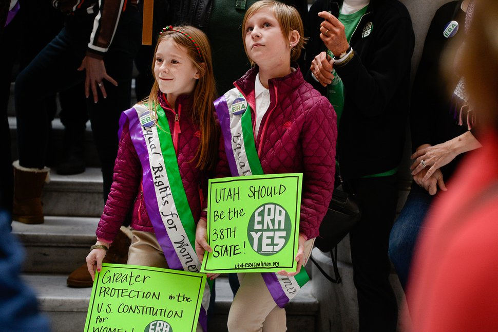 (Francisco Kjolseth | The Salt Lake Tribune) Abby Guymon, left, and her twin sister, Kate, 10, join other local supporters of the Equal Rights Amendment for a rally at the Utah Capitol on Tuesday, Dec. 3, 2019, to encourage Utah to ratify the ERA.