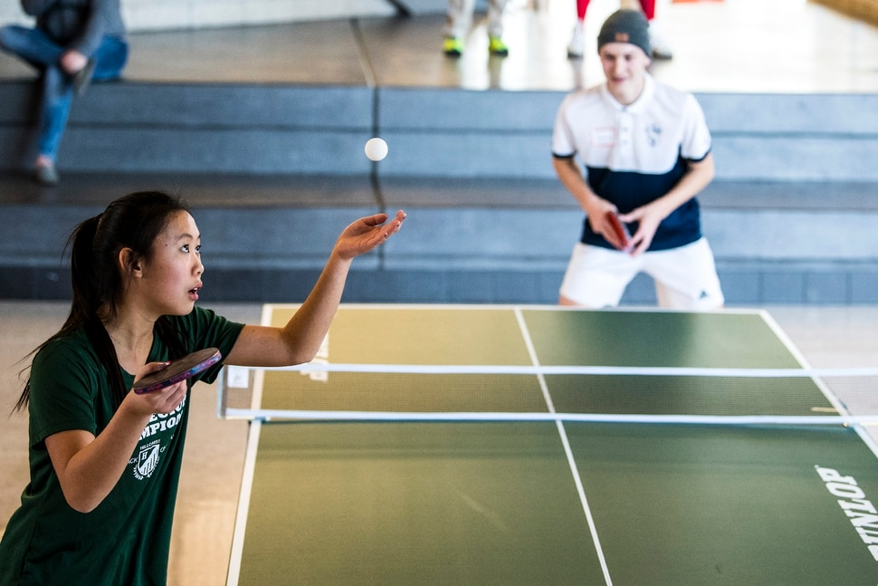 (Chris Detrick | The Salt Lake Tribune) Hillcrest junior Tammie Tam serves the ball to Syracuse junior Tanner Bouwhuis during the first state-wide Utah High School Table Tennis Tournament at Granger High School Saturday, January 13, 2018. Organized by math teacher Walter Poelzing and sponsored by Salt Lake City Table Tennis, 46 high school students from all over the state competed. ÒPing Pong is not just a garage game, itÕs a serious sport,Ó said Walter Poelzing, math teacher at Granger High School and organizer of the Invitational. ÒWhen you look internationally, itÕs one of the top sports played around the world, along with soccer. Here in Utah, table tennis is just beginning, but we have a few top national players in our state. WeÕre excited to host this special event; these high school kids are intense, focused and committed to win.Ó Schools participating include Hillcrest, Brighton, Granger, Skyline, Waterford, Syracuse, Cottonwood, American Fork, Bingham,Taylorsville, Itineris Early College High School and Wasatch.