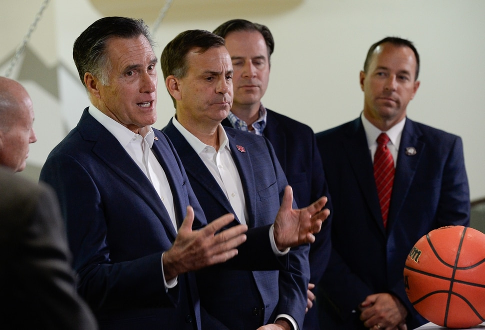 (Francisco Kjolseth | The Salt Lake Tribune) Sen. Mitt Romney, left, is joined by Utah athletic directors to talk about ways to increase the compensation to student athletes following a meeting at the University of Utah on Friday, Nov. 15, 2019. Romney has been putting pressure on the NCAA to allow athletes to make money off of their likeness or for appearances. Pictured to his right are athletic directors Mark Harlan, U. of U., Shaey Wyatt, Westminster College, and Jason Boothe, Dixie State University.