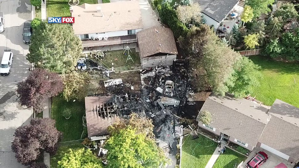 (Courtesy of FOX 13) An aerial view of the crash site where a small plane, carrying six passengers, struck a residential neighborhood in West Jordan on Saturday, July 25, 2020.