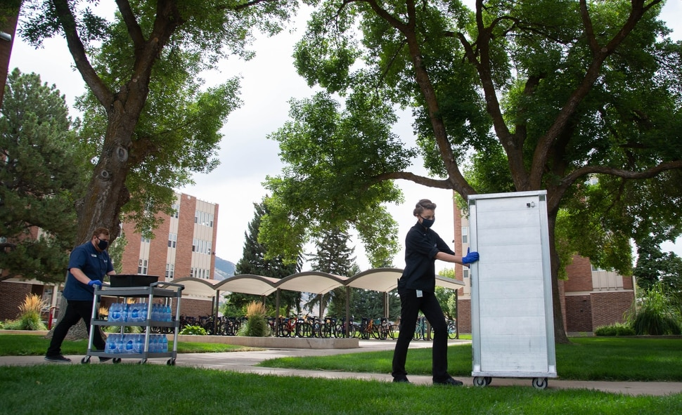 (Francisco Kjolseth | The Salt Lake Tribune) Bag lunches are delivered to four Utah State University dormitories on Monday, August 0831, 2020, where 287 residents were asked to quarantine after elevated levels of COVID-19 were found in wastewater samples.