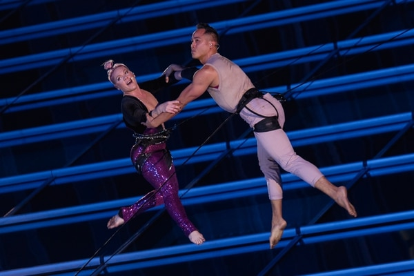 """(Photo courtesy of Katherine Barcsay) Oakland, Calif.-based """"vertical dance"""" company BANDALOOP performs with pop star P!nk on the JW Marriott building in Los Angeles at the 2017 American Music Awards. BANDALOOP will be appearing at the Utah Arts Festival June 21-24, and will perform twice daily (5:30 and 7 p.m.) on the six-story library glass wall above the reflecting pool."""