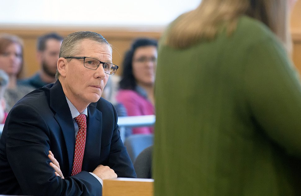 Prosecuting attorney James Swink listens during a court hearing in Logan in 2018.