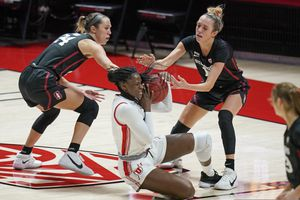 Stanford's Lacie Hull (24) and Lexie Hull, right, defend against Utah forward Lola Pendande (12) in the first half during an NCAA college basketball game Friday, Jan. 15, 2021, in Salt Lake City. (AP Photo/Rick Bowmer)