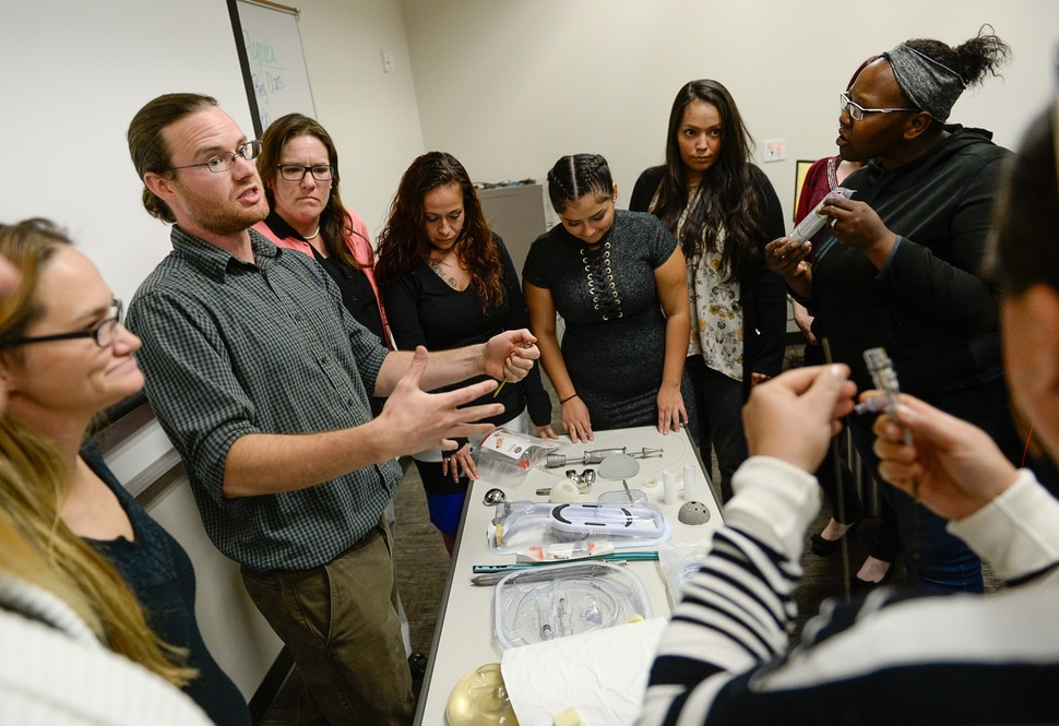 (Francisco Kjolseth | The Salt Lake Tribune) Kevin Buckingham with Nelson Laboratories talks about FDA regulations on medical devices during a class for single mothers participating in the Invest in You Too program, a 13-week course that helps single mothers build skills in medical manufacturing and job readiness to open the doors for employment. Currently, several students in the second cohort who are experiencing intergenerational poverty are taking steps to break the cycle. Some of the students have also experienced homelessness, domestic abuse and drug addiction.