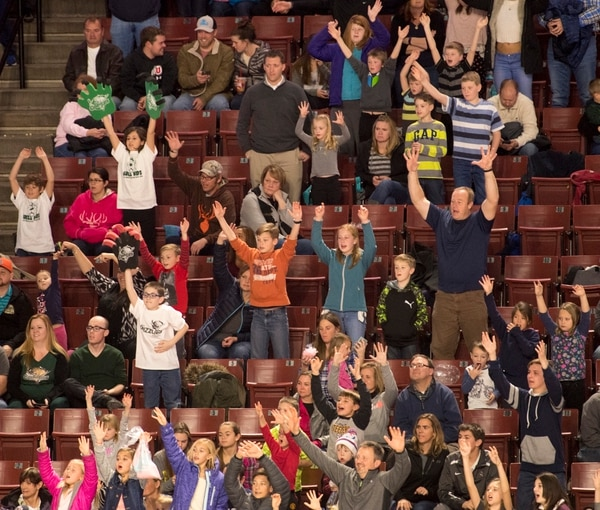 Rick Egan | The Salt Lake Tribune Utah Grizzlies fans cheer in hopes of getting a t-shirt, during a break in ECHL hockey action, Utah Grizzlies vs. Idaho Steelheads, during the annual Martin Luther King Holiday matinee game, at the Maverick Center, Monday, January 16, 2017.
