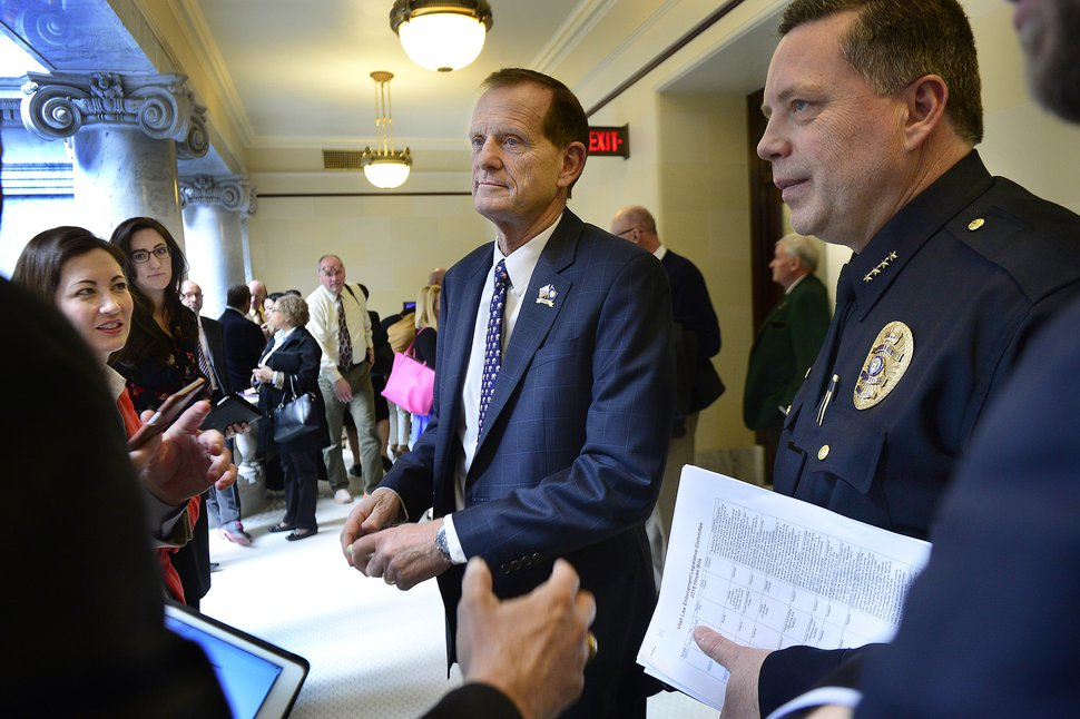 (Scott Sommerdorf | Tribune file photo) In this Feb. 24, 2016, file photo, Rep, Brad Dee, R-Ogden, talks with lobbyists outside the House chamber about his bill, HB380, Utah Communications Authority Amendments.