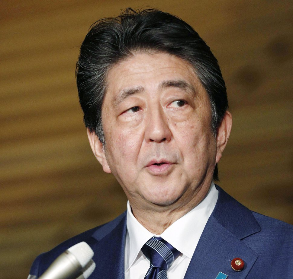 Japan's Prime Minister Shinzo Abe speaks to reporters on a Japanese freelance journalist freed from Syria, at his official residence in Tokyo Wednesday, Oct. 24, 2018. A Japanese freelance journalist who was freed after more than three years of captivity in Syria said Wednesday he is safe in neighboring Turkey. (Kyodo News via AP)