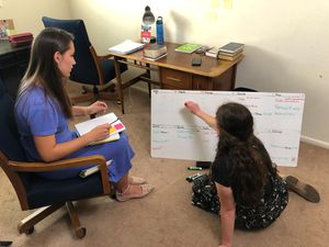 (Photo courtesy of The Church of Jesus Christ of Latter-day Saints) Two missionaries who were serving in Brazil have been reassigned to a Portuguese-speaking congregation in Salt Lake City. Mauri Dobbs, left, and Hannah Davidson make a plan for the week in their apartment, Thursday, May 28, 2020.