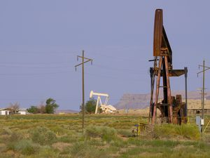 (Leah Hogsten | Tribune file photo) Crude oil pumpjacks, defunct, at right, and fully operational, at left, in San Juan County.