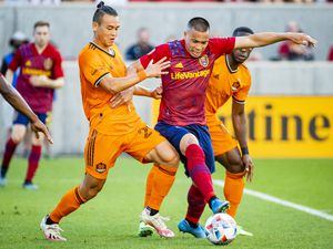 (Isaac Hale   Special to The Tribune) Real Salt Lake forward Bobby Wood (7) tries to drive the ball away from Houston defenders during a MLS game between Real Salt Lake and Houston Dynamo FC at Rio Tinto Stadium in Sandy on Saturday, June 26, 2021.