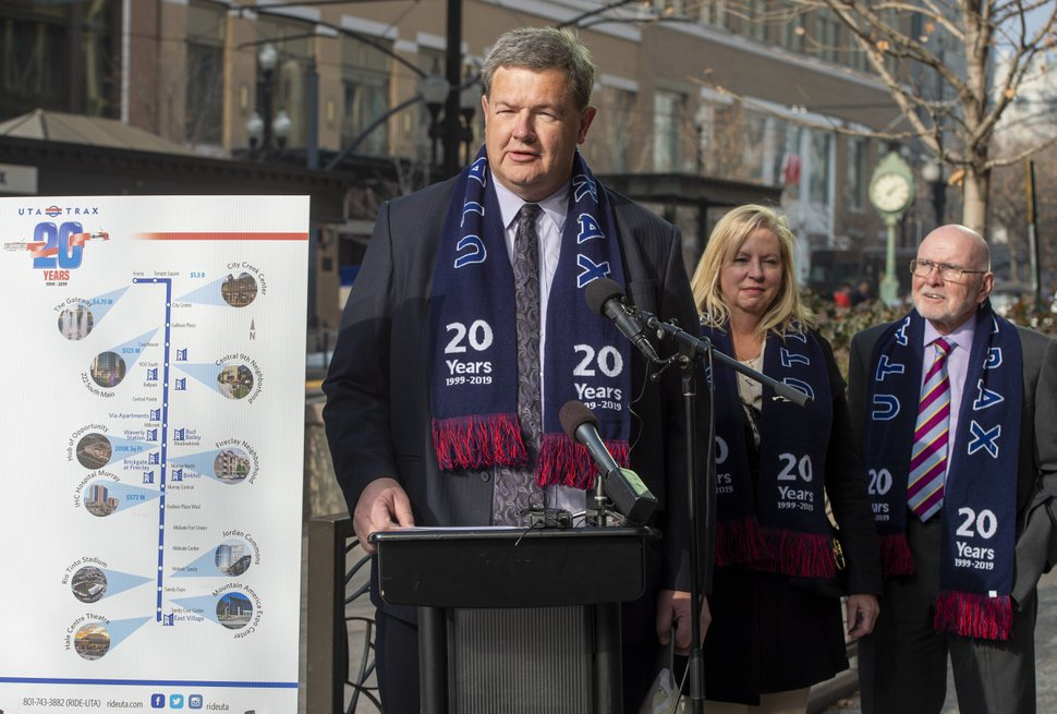 (Rick Egan | Tribune file photo) Carlton Christensen speaks as officials celebrate the 20th anniversary of TRAX trains during a news conference at the City Creek Trax stop on Main Street in Salt Lake City on Dec. 4, 2019.