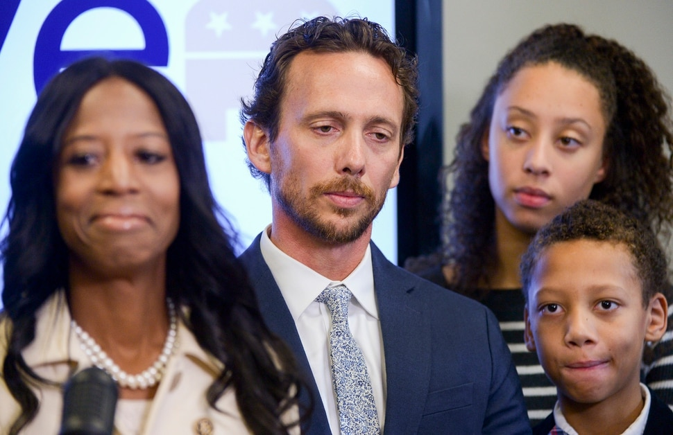 Leah Hogsten | The Salt Lake Tribune l-r When asked if she plan to run again, Mia Love said, ÒI donÕt know. WeÕll see.Ó Love is joined at the lecturn with her husand Jason Love, daughter Alessa and son Peyton. Mia Love, the former two-term republican representative from Utah's 4th Congressional District held a press conference at the Utah Republican Party headquarters, Nov. 26, 2018 to discuss her accomplishments, Washington politics, President Donald Trump and her future.