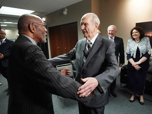 (Courtesy of The Church of Jesus Christ of Latter-day Saints) President Russell M. Nelson of The Church of Jesus Christ of Latter-day Saints, and his wife, Wendy, are greeted by NAACP President and CEO Derrick Johnson at the NAACP's 110th annual national convention in Detroit on Sunday, July 21, 2019.