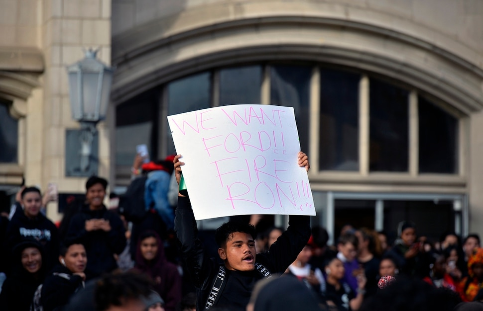 (Chris Samuels | The Salt Lake Tribune) A student carries a sign in support of principal Ford White during a walkout at West High School in Salt Lake City, Tuesday, Nov. 19, 2019.
