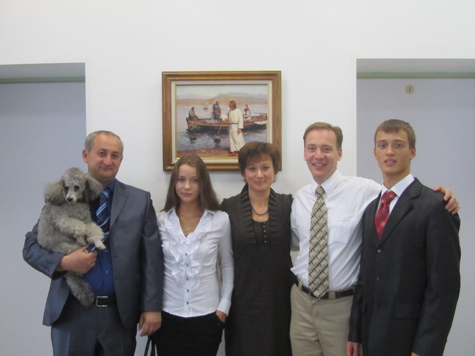 (Photo courtesy of David Stewart) David Stewart, second from right, who had served a mission in Russia in the early 1990s, with a convert and her family in a chapel in St. Petersburg in 2010.