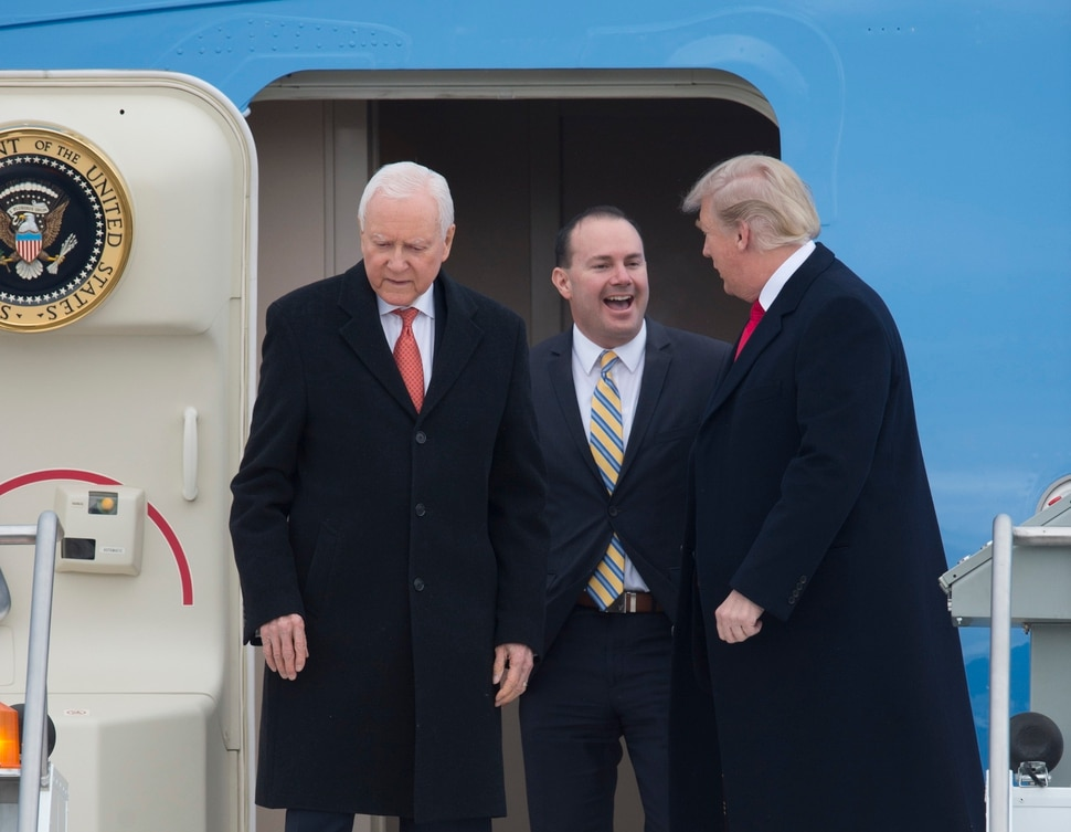 (Scott Sommerdorf | The Salt Lake Tribune) President Trump deplanes from Air Force One with Senators Hatch and Lee at the Ronald R Wright National Air Guard Base, Monday, December 4, 2017.