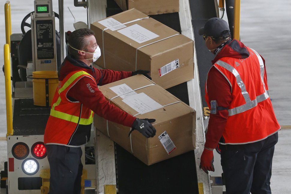 A plane filled with personal protective equipment is unloaded at the Delta Hanger Wednesday, April 15, 2020, at the Salt Lake International Airport. The first of several planes filled with personal protective equipment touched down in Utah, delivering masks and eye protection for health care workers throughout the state.