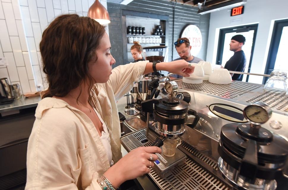 (Francisco Kjolseth | The Salt Lake Tribune) Katie Mansfield prepares an order for a customer at Publik Ed's.