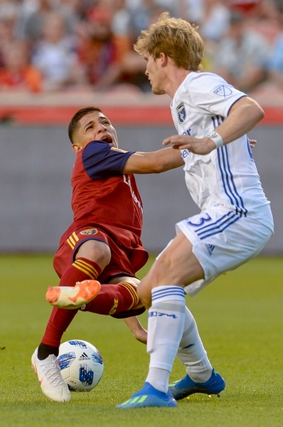 Leah Hogsten | The Salt Lake Tribune Real Salt Lake forward Jefferson Savarino (7) gets a free kick after San Jose Earthquakes midfielder Florian Jungwirth (23) kicks his leg from under him as Real Salt Lake hosts the San Jose Earthquakes at Rio Tinto Stadium in Sandy, Utah, Saturday, June 23, 2018.