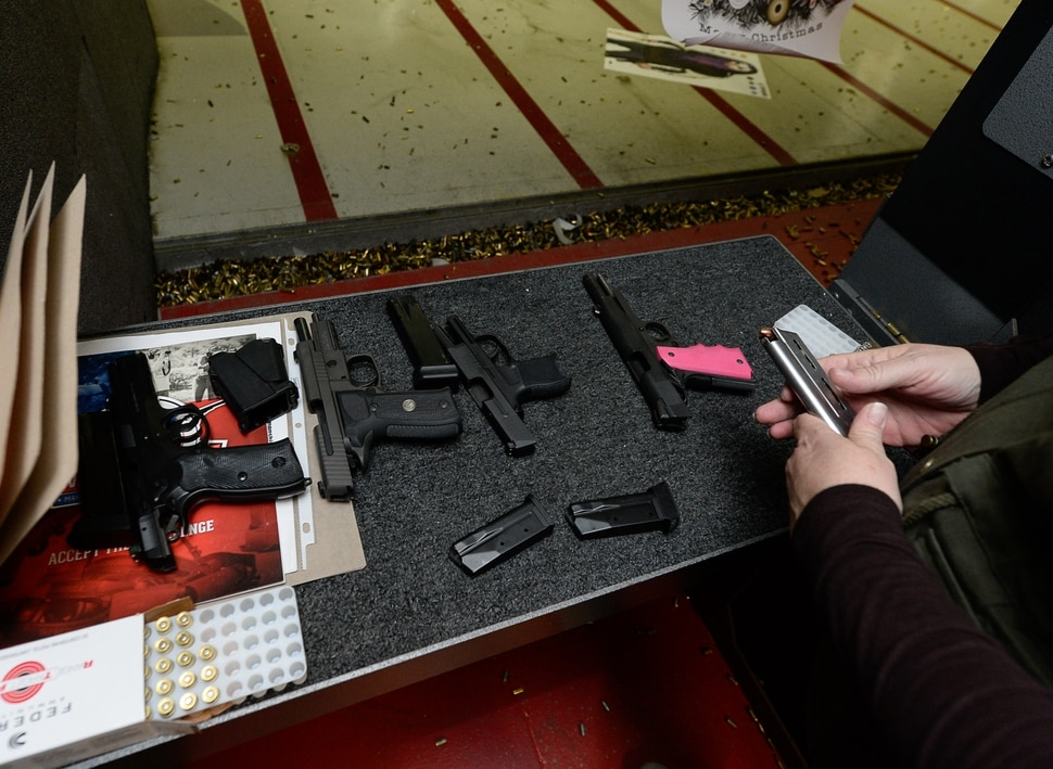 (Francisco Kjolseth   The Salt Lake Tribune) Michelle Camp loads guns during a training session at the Gun Vault in South Jordan. Camp is the state leader of The Well-Armed Woman chapters in Utah where women with concealed carry permits meet once a month. Of the concealed carry permits issued by the state, only about one in five is held by a woman.