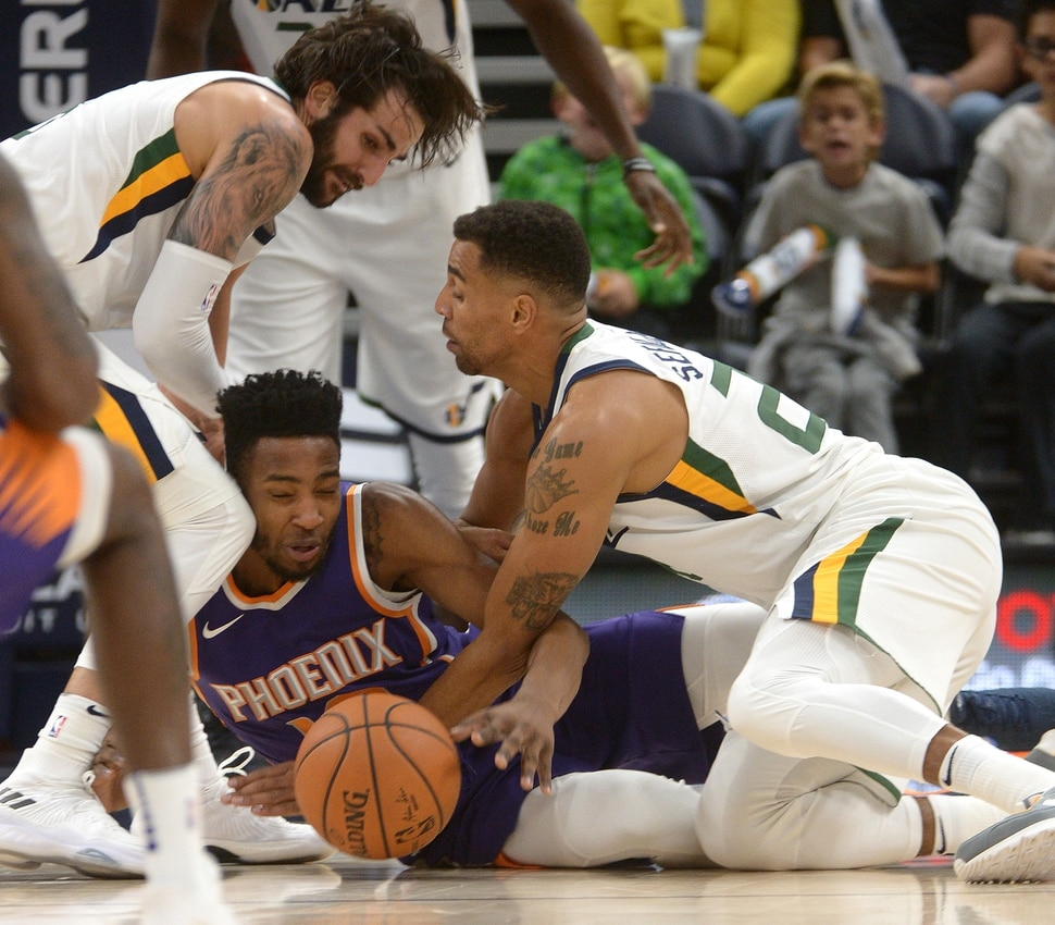 (Leah Hogsten | The Salt Lake Tribune) Utah Jazz guard Ricky Rubio (3) and Utah Jazz forward Thabo Sefolosha (22) pressure Phoenix Suns forward Derrick Jones Jr. (10) for the ball. The Utah Jazz defeated the Phoenix Suns 112-101 during preseason NBA basketball at Vivint Smart Home Arena in Salt Lake City, October 6, 2017.