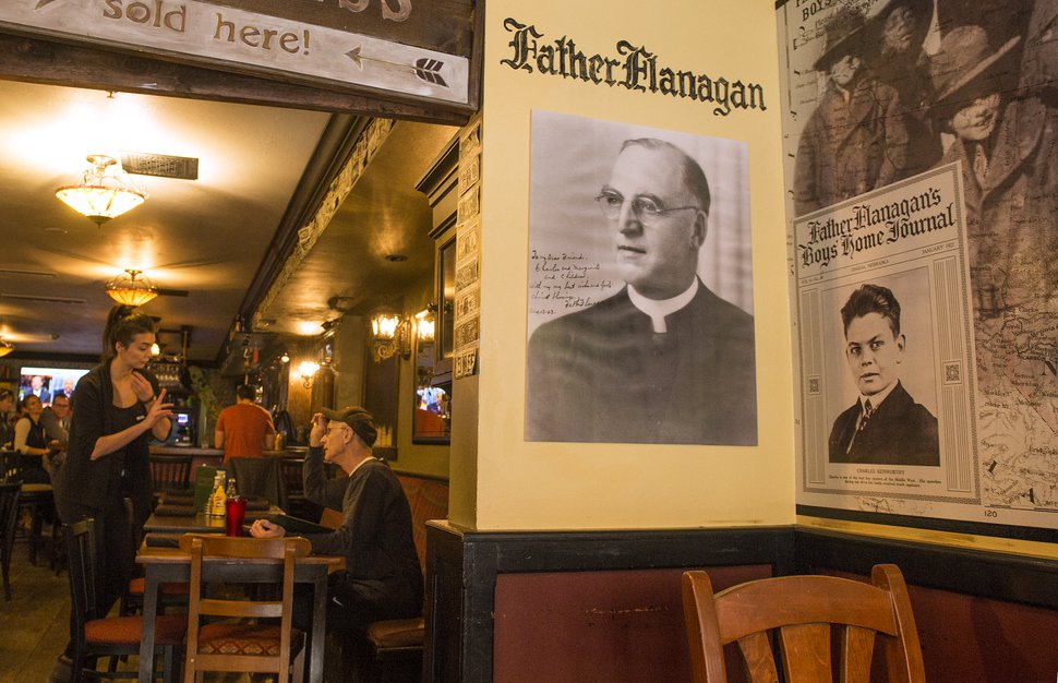 Leah Hogsten | The Salt Lake Tribune A photo of Father E.J. Flanagan adorns the wall of Flanagan's on Main, an Irish pub in Park City