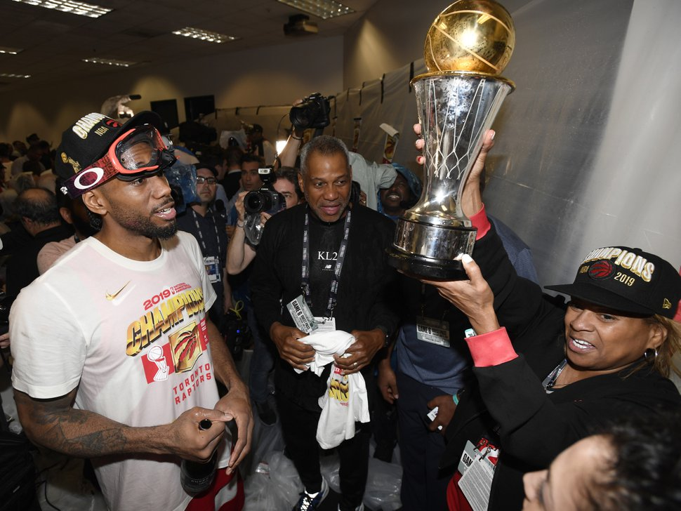 Toronto Raptors forward Kawhi Leonard, left, and his mother, Kim Robertson, celebrate after the Raptors' 114-110 win over the Golden State Warriors in Game 6 of basketball's NBA Finals, Thursday, June 13, 2019, in Oakland, Calif. (Frank Gunn/The Canadian Press via AP)