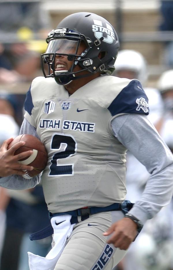 Leah Hogsten | The Salt Lake Tribune Quarterback Kent Myers with a gain of yards during Utah State University football team's annual Blue vs. White Spring Game, Saturday, April 8, on Merlin Olsen Field at Maverik Stadium.