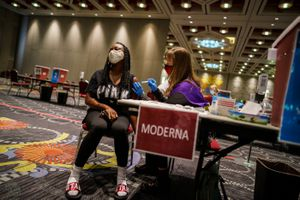 (Trent Nelson | The Salt Lake Tribune) Melanie Wolcott vaccinates Latasha Roddan on the last day the Salt Lake County Health Department's COVID-19 vaccine operation was open at the Salt Palace Convention Center in Salt Lake City, Saturday, May 29, 2021.