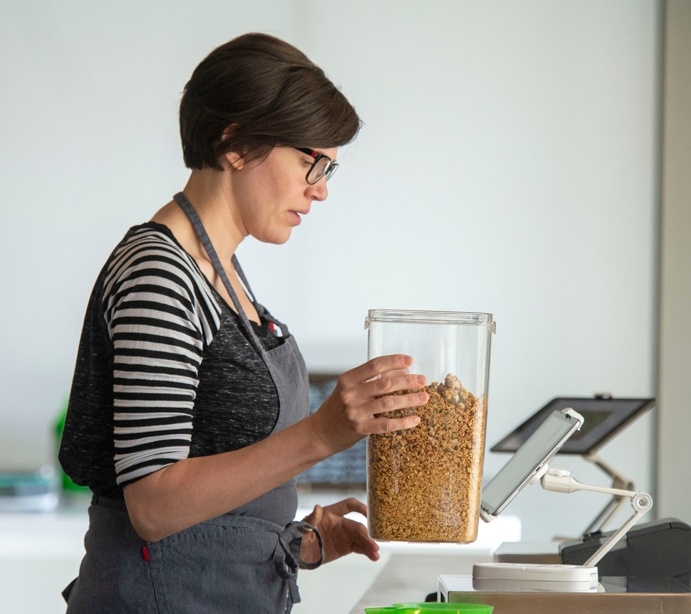 (Rick Egan | The Salt Lake Tribune) Faith Swanberg weighs some granola at the Hello Bulk Market, a package-free grocery store in Salt Lake City. Wednesday, May 1, 2019.