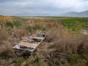 (Francisco Kjolseth   The Salt Lake Tribune) An abandoned boat sits on one of the many dried up ponds in the Bear River Migratory Bird Refuge, a 74,000-acre nature reserve in the northern Great Salt Lake on Wednesday, June 23, 2021.