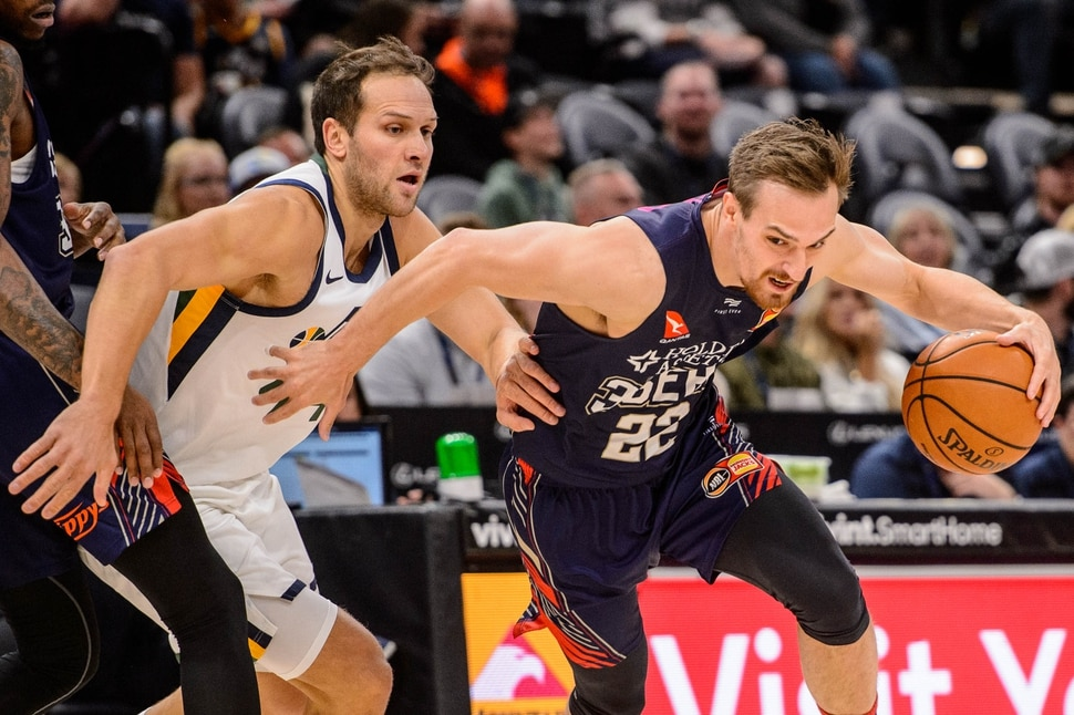 (Trent Nelson | The Salt Lake Tribune) Adelaide 36ers forward Anthony Drmic (22) drives around Utah Jazz forward Bojan Bogdanovic (44) as the Utah Jazz host the Adelaide 36ers, NBA basketball in Salt Lake City on Saturday, Oct. 5, 2019.