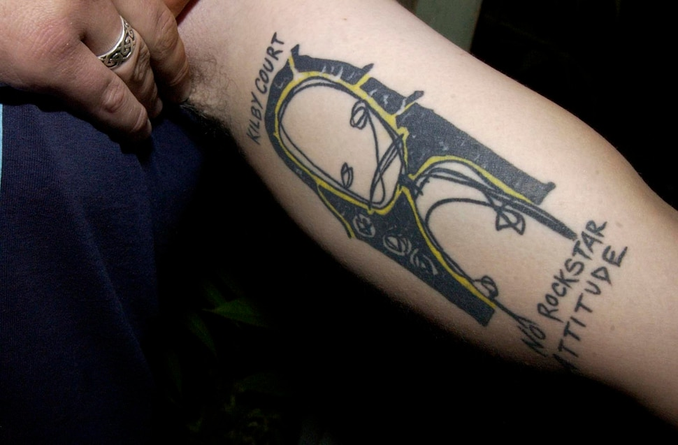 (Ryan Galbraith | Tribune file photo) In this 2004 file photo, a tattoo on the arm of Kilby Court employee Mike Snider. Salt Lake City's all-ages music venue turns 20 this year.