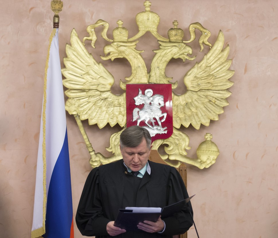 (AP Photo/Ivan Sekretarev) Russia's Supreme Court Judge Yuri Ivanenko reads the decision in a courtroom in Moscow, Russia, on Thursday, April 20, 2017. Russia's Supreme Court has banned the Jehovah's Witnesses from operating in the country, accepting a request from the justice ministry that the religious organization be considered an extremist group.