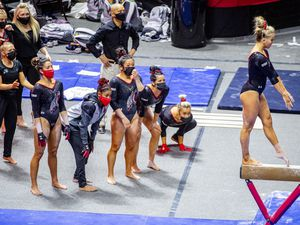 (Isaac Hale | Special to The Tribune) Utah's Adrienne Randall competes on the balance beam while her teammates cheer her on during a gymnastics meet between the University of Utah and the University of California, Berkeley, held at the Jon M. Huntsman Center in Salt Lake City on Friday, Feb. 26, 2021.