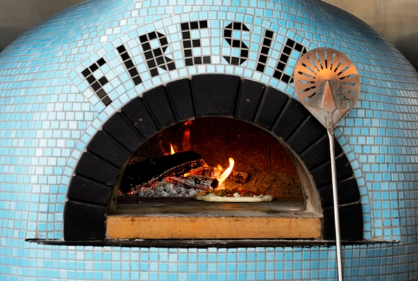 (Steve Griffin | The Salt Lake Tribune) A pizza cooks in the Valoriani oven at Fireside on Regent in Salt Lake City.